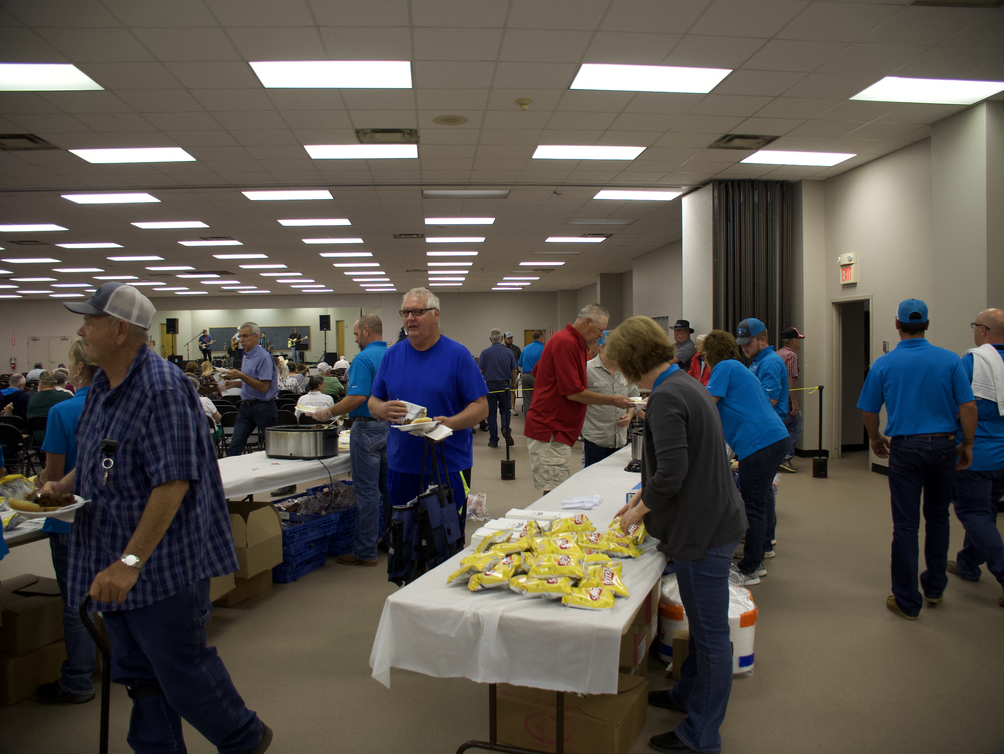 people getting food at the annual meeting