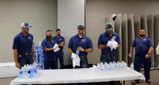 Cimarron employees handing out water