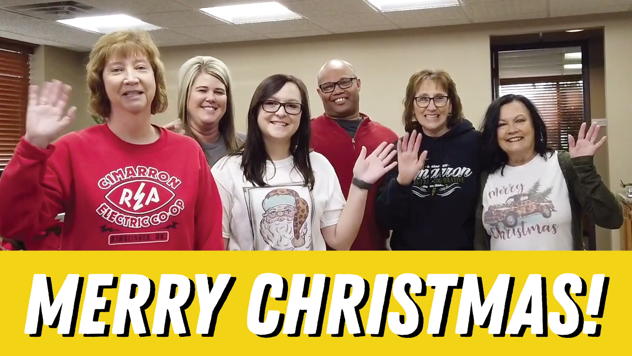 merry christmas with cimarron employees waving