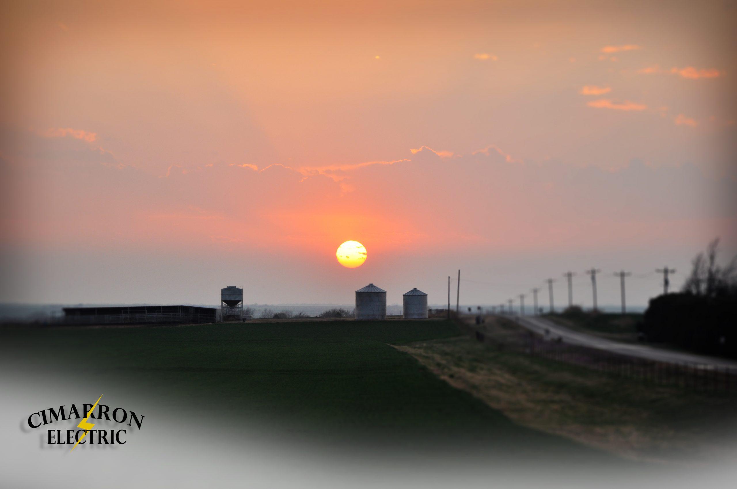 sunset over grain bins