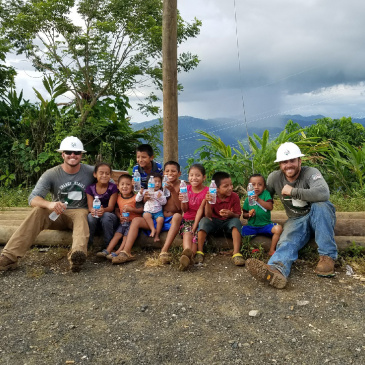 linemen with guatemalan kids
