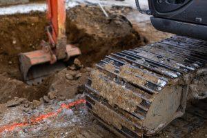 digger machine digging a hole