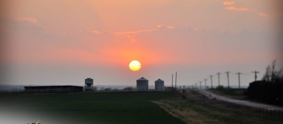 sunset over grain bins